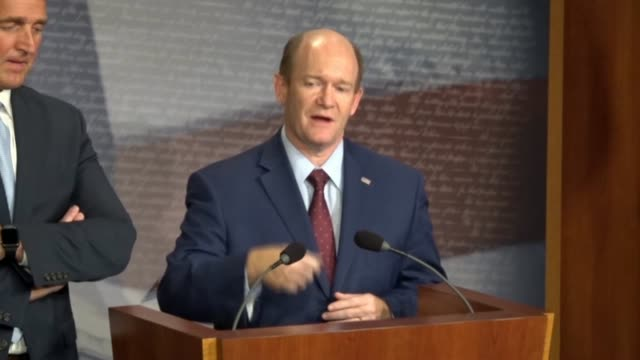 Delaware Senator Chris Coons tells reporters at a news conference after a bipartisan bill to protect special counsel Robert Mueller was objected to...