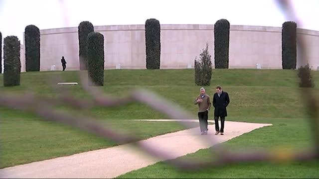 day's reactions ENGLAND Staffordshire National Memorial Arboretum EXT Close Shot Iraq war memorial stone at arboretum Setup shot of Reg Keys walking...