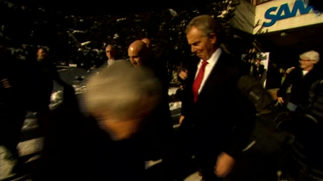 day's reactions SWITZERLAND Davos Tony Blair along surrounded by press as asked by reporter NATSOT if voters have a right to know the contents of the...