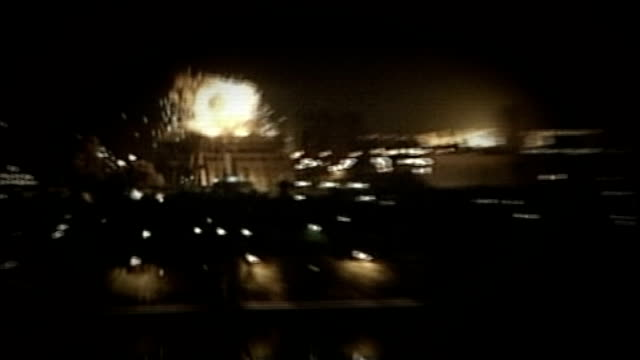 day's reactions via REUTERS IRAQ Baghdad EXT / NIGHT Long shots of 'shock awe' allied bombardment of Iraq