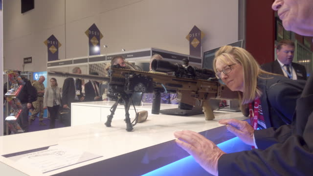 delegate looks through the sights on an fn herstal scar-h pr rifle on day one of the dsei arms fair at excel on september 10, 2019 in london,... - rifle stock videos & royalty-free footage