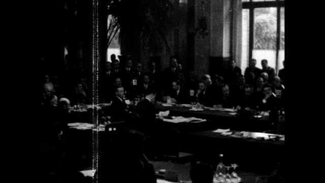 delegates at tables paris peace conference president woodrow wilson tipping hat w/ wife first lady edith bolling wilson ms tiga komoso french pm... - 1910 1919 stock videos and b-roll footage