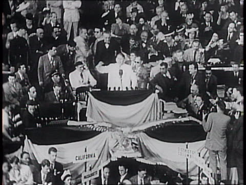 delegates enter the chicago democratic national convention / delegates in the seats and on the floor of the hall / senator alben barkley speaks to... - new deal video stock e b–roll