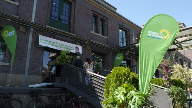 delegates enter the event venue a banner from the green party can be seen as well a greens party congress ahead of european elections on may 18 2019... - green party stock videos and b-roll footage