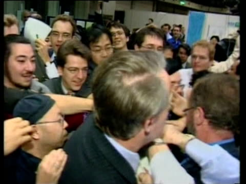 delegates grabbing for copies of draft conference resolutions kyoto earth summit 1997 - 1997 stock videos & royalty-free footage