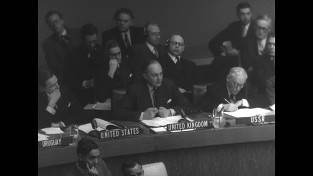delegates in un session; quick pan to uk delegate sir gladwyn jebb speaking seated between us delegate henry cabot lodge, jr. and ussr delegate... - hand raised stock videos & royalty-free footage