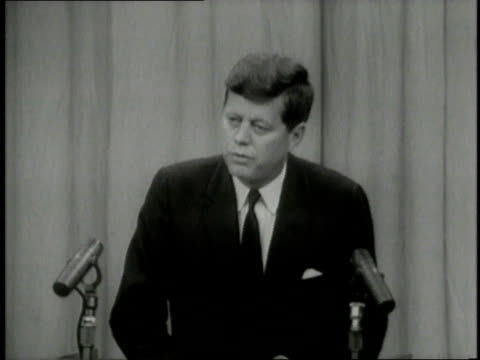 delegates listening / john f. kennedy speaking at podium / men walking with children in slum neighborhood - lectern stock videos & royalty-free footage