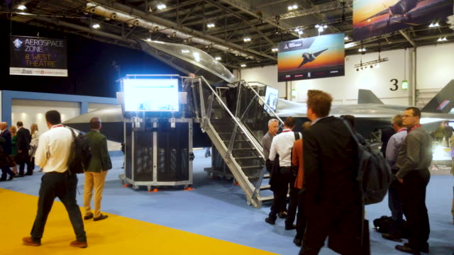delegates queue to sit in a tempest jet fighter. - exhibition stock videos & royalty-free footage