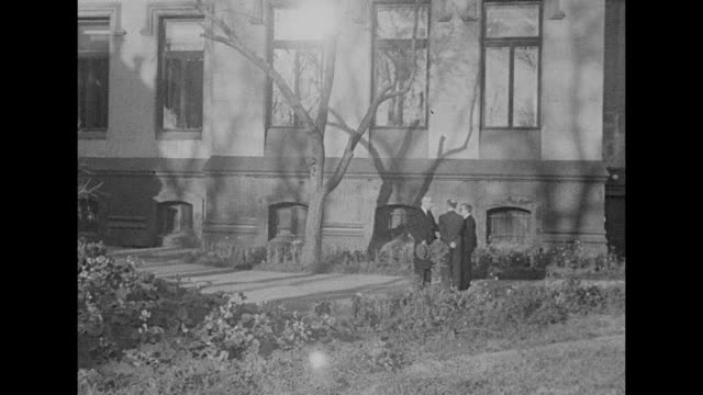 delegates to moscow conference 1943 take smoke break in the spiridonovka palace garden / british foreign secretary anthony eden smokes with fellows /... - vyacheslav m. molotov stock videos and b-roll footage