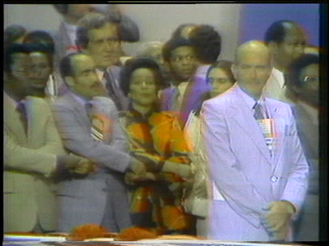"""delegates to the 1976 democratic national convention sing """"we shall overcome."""" - united states and (politics or government) stock videos & royalty-free footage"""