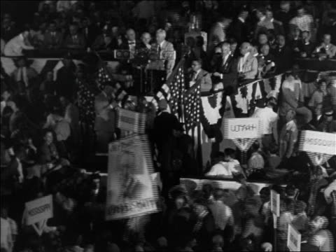 vídeos y material grabado en eventos de stock de delegates with al smith signs at democratic national convention / houston / documentary - 1928