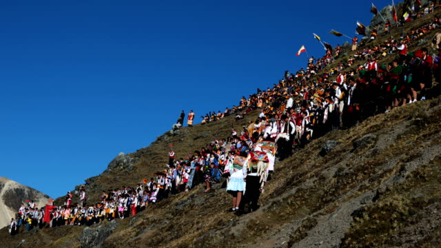 a delegation decends the mountain side after gathering to watch the sun rise during the annual qoyllur rit'i festival on may 28 2018 in ocongate peru... - religious celebration stock videos & royalty-free footage