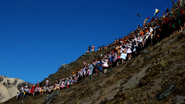 A delegation decends the mountain side after gathering to watch the sun rise during the annual Qoyllur Rit'i festival on May 28 2018 in Ocongate Peru...