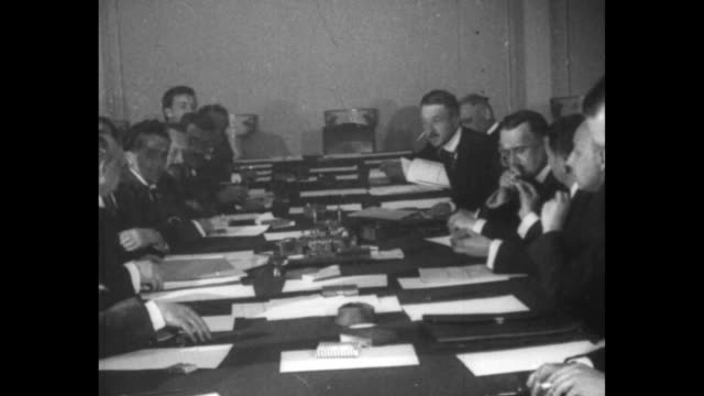 delegations gather in soviet foreign office / delegations seated at long conference table germans on right russians on left side / german ambassador... - ambassador stock videos & royalty-free footage