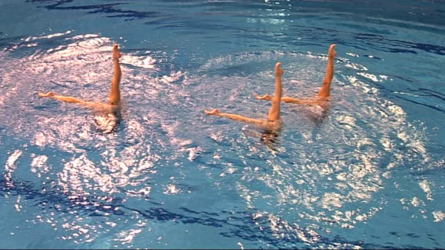 2010 Commonwealth Games England synchronised swimming team Girls practising their positions poolside then in the water Top Shots of training routine...