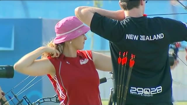 delhi 2010 commonwealth games: problems with buildings and security worries; new zealand and england archery team practicing danielle brown interview... - commonwealth games stock videos & royalty-free footage