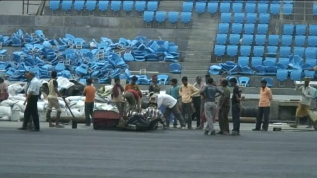 2010 commonwealth games will go ahead as planned india delhi general views of the unfinished field hockey stadium including construction workers bank... - field hockey stock videos and b-roll footage