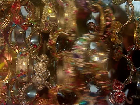 general views chains of sparkling gold and bejewelled bangles and bracelets turned around on stand - bangle stock videos & royalty-free footage