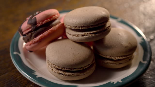 delicious and colorful french macaroons (macarons) pastries stacked on a plate. - french food stock videos & royalty-free footage