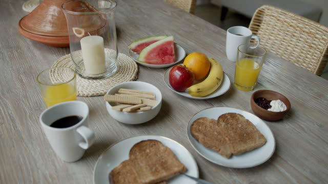 delicious breakfast set on dining table at home - wood plate stock videos & royalty-free footage