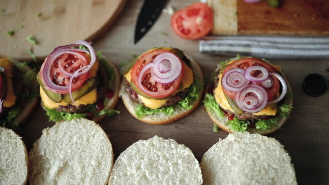 delicious burgers soon to be done - preparing food stock videos & royalty-free footage