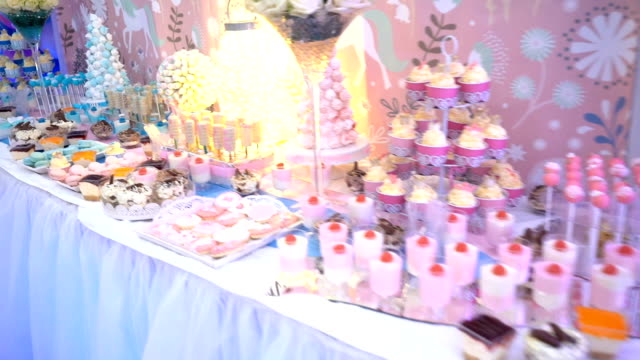 delicious child birthday reception candy dessert table stock video - sweet food stock videos & royalty-free footage