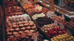 Delicious chocolate sweets are lying on showcase of oriental traditional market