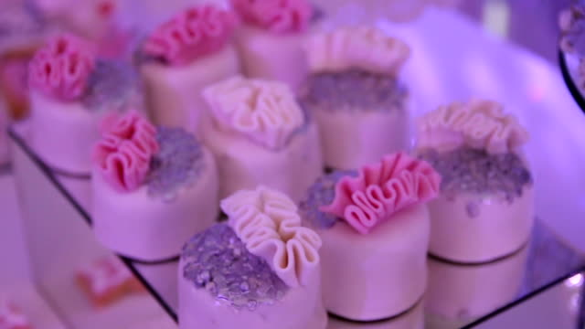 Delicious  cookies and cakes on the wedding candy bar