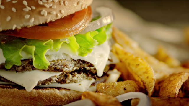 slo mo ds delicious double hamburger and crispy potato wedges - hamburger stock videos and b-roll footage