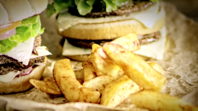 SLO MO DS Delicious double hamburgers and crispy potato wedges