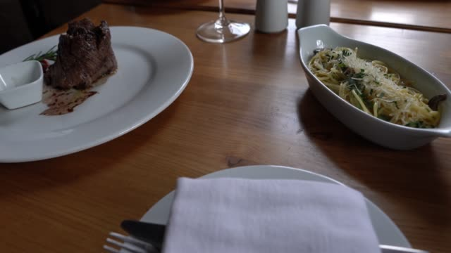 delicious food on table at a restaurant - steak stock videos & royalty-free footage
