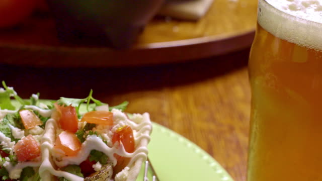 delicious grilled shrimp street tacos and beer - cilantro stock videos and b-roll footage