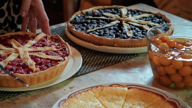 delicious homemade pies with berries, raspberries, blueberries and cherries. dessert. - cranberry stock videos & royalty-free footage