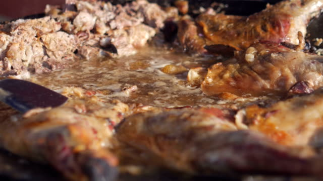 delicious meat soup boiling on the stove - grigliare video stock e b–roll