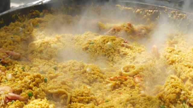 delicious paella typical spanish food - mediterranean culture stock videos & royalty-free footage