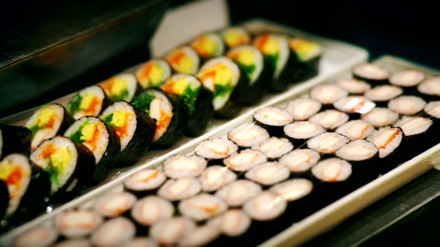 delicious pieces of sushi bar in a buffet corner of the table. - seaweed stock videos & royalty-free footage