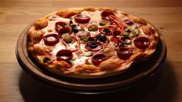 delicious pizza spinning on table - cultura italiana video stock e b–roll