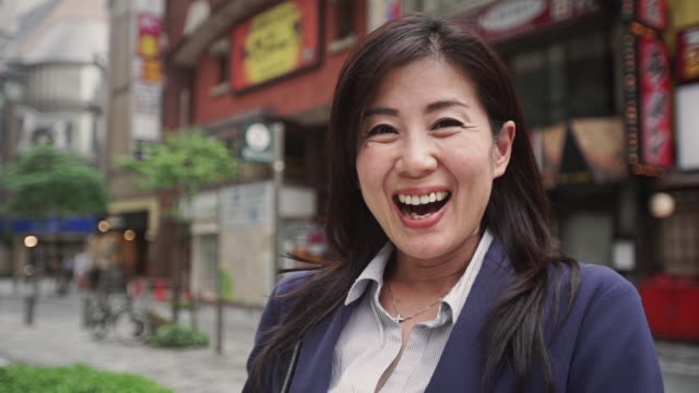 delighted woman turning to camera - only japanese stock videos & royalty-free footage