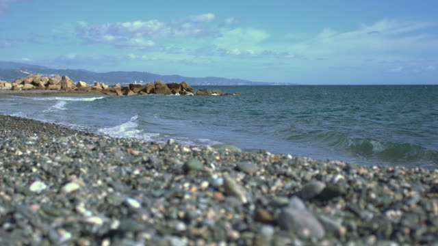 delightful beach of little stones and mountains - silvestre stock videos & royalty-free footage