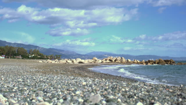 Delightful beach of little stones and mountains