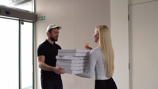 delivering pizzas to office - delivery person stock videos & royalty-free footage