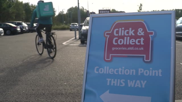 deliveroo collecting shopping from aldi supermarket in loughborough as they expand their services with home delivery and click and collect - delivering stock videos & royalty-free footage