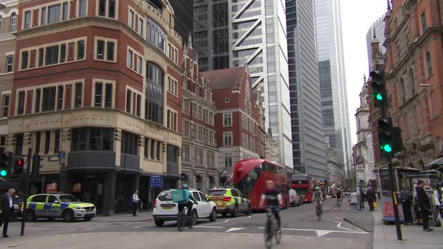 deliveroo share prices underwhelming on first day of trading; england: london: ext deliveroo delivery rider along road on bike gv delivery rider... - data stock videos & royalty-free footage
