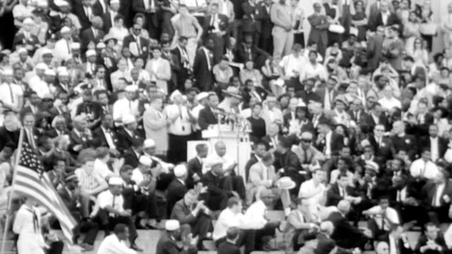 vídeos de stock e filmes b-roll de mlk delivers his i have a dream speech during the civil rights march on washington / crowds surrounding him as he is at podium / mlk says i have a... - 1963