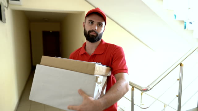 delivery boy ringing on the doorbell and waiting - postal worker stock videos & royalty-free footage