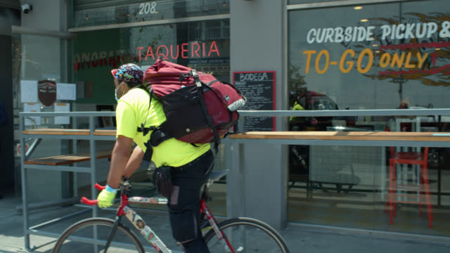 Delivery Cyclist Riding From Restaurant During Covid-19 Lockdown