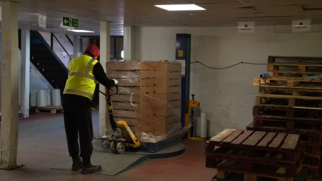 a delivery driver moves a pallet of loaves of bread for the nhs at the bread factoryon april 14 2020 in london england during the covid19 outbreak... - preparing food stock videos & royalty-free footage