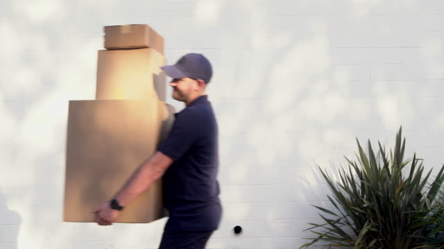 ms delivery man carrying boxes - package stock videos and b-roll footage
