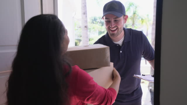 ms delivery man delivering packages to a home. - receiving stock videos & royalty-free footage