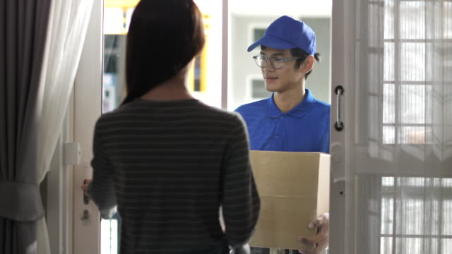 delivery man delivery parcel at home, order from online shopping - loading screen stock videos & royalty-free footage